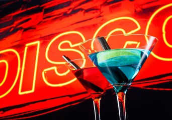 blue and red cocktail with neon disco word background