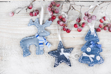 Christmas tree, reindeer and star on a branch with berries