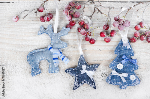 canvas print picture Christmas tree, reindeer and star on a branch with berries