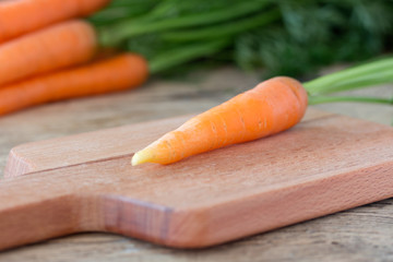 separately placed carrot on cutting board