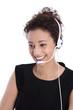 Freigestellte junge Frau mit Headset lachend