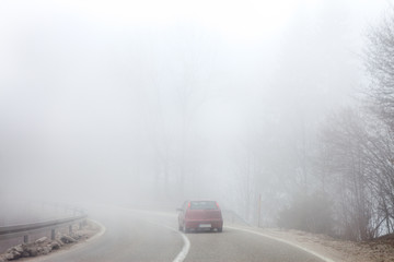 Road in thick fog
