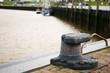 canvas print picture - empty bollard in Bensersiel-Harbour