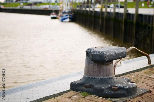 canvas print picture empty bollard in Bensersiel-Harbour