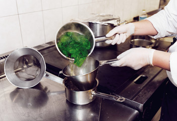 Chef is blanching fresh spinach