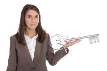 Konzept: Schlüsselübergabe - Frau mit Schlüssel isoliert