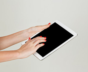 Female hands holding tablet