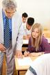 Teacher observes his  students