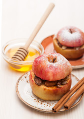 Stuffed baked apples with cinnamon, raisins, honey and nuts