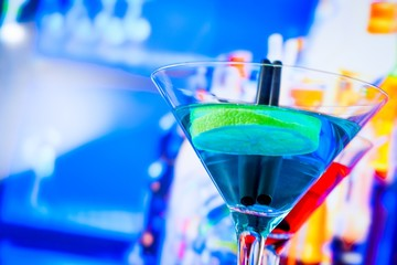blue and red cocktail with lounge bar background