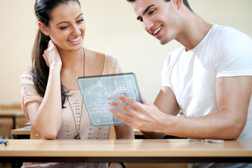 students with futuristic tablet