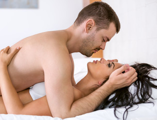 Young passion couple in bed