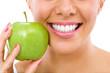 Leinwanddruck Bild - woman with an apple