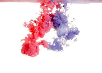 Red and purple paint in water