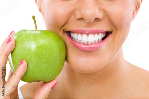 Leinwanddruck Bild woman with an apple