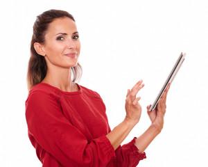 Charming hispanic woman using her tablet pc