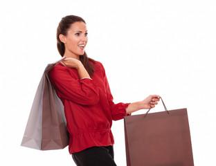 Shopaholic hispanic female with shopping bags