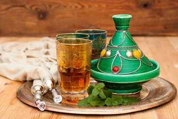 Tagine and Moroccan tea with mint on a metal tray