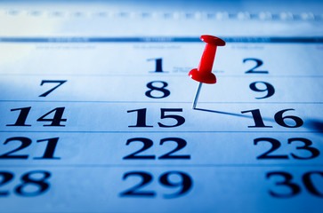 Red pin marking the 15th on a calendar