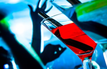 detail of blue and red cocktail drink on a disco table