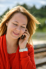 Beautiful caucasian girl talking to phone