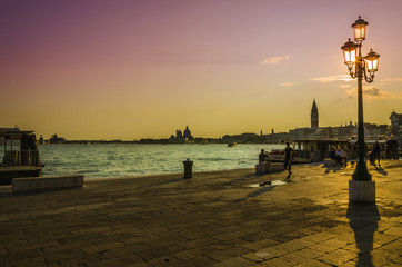 Colorful sunset on the Grand Canal in Venice, Italy.