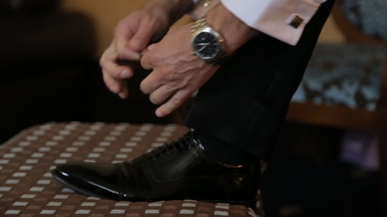 Man hands  tying shoes