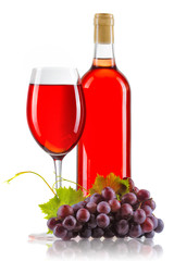 Glass of rose wine with bottle and ripe grapes isolated