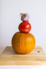 Pumpkin, tomatoes, garlicon a table