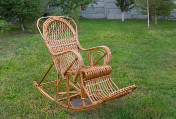 Wicker rocking-chair in the garden