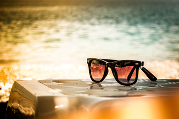 Sun glasses on a beach