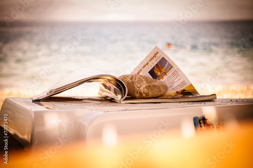 Magazine on a beach - 70173470