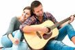 Young couple playing guitar