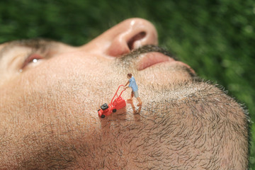 Little People Mowing Hair off a Mans Face