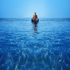 Man meditating upon the ocean
