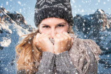Young woman winter portrait under the snow