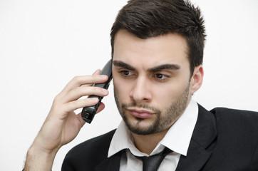 Businessman talking on phone concerned