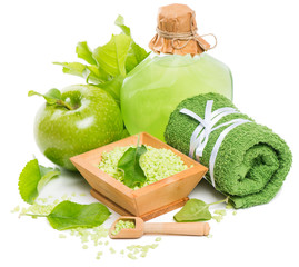 Natural spa setting with products of green apple