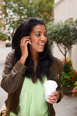 woman with coffee talking on the phone.