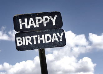 Happy Birthday sign with clouds and sky background