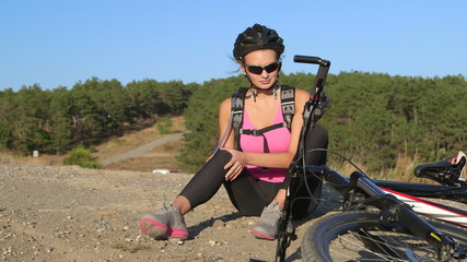 Workout fitness injuries woman cyclist with pain in knee joint