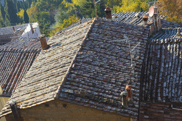 Close up of the traditional Italian red roof tiles in a small vi