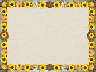 herbstlicher Rahmen mit Sonnenblumen und Kürbis, auf Steintextur