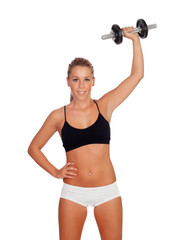 Attractive girl training with dumbbells