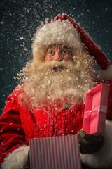 Santa Claus opening giving xmas present
