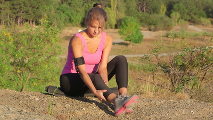 Workout fitness injuries young woman with pain in the leg
