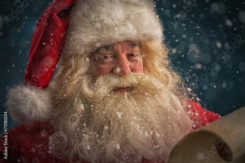 canvas print picture Santa Claus reading Christmas letter