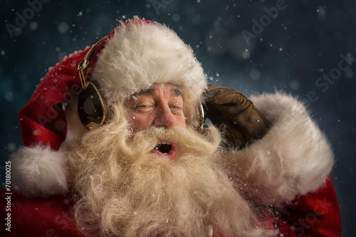 Leinwanddruck Bild Santa Claus is listening music