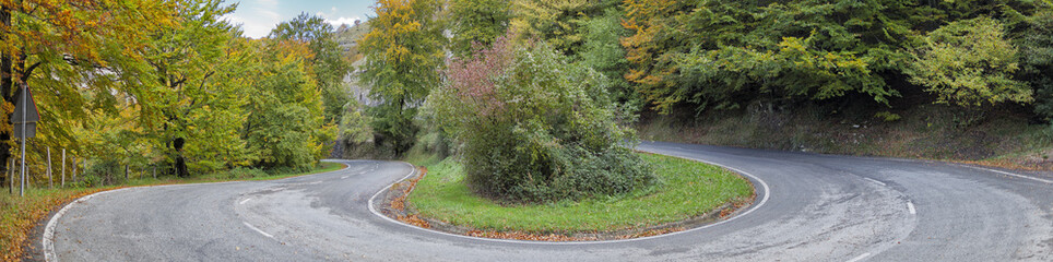 Mountain road.Autumn colors.Panorama.