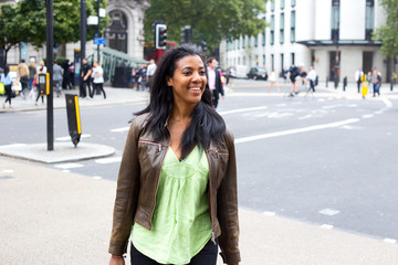 happy young woman crossing the road.